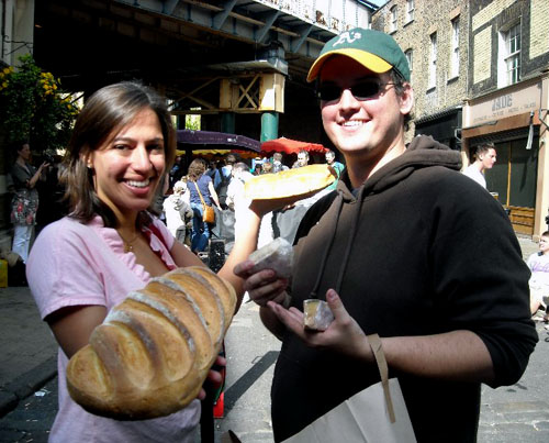 chris and sasha with the bread and cheese