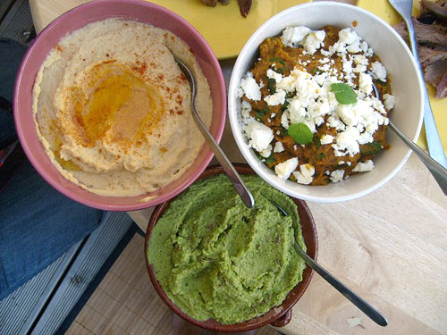 hummous, carrot and caraway, pea and cumin dips