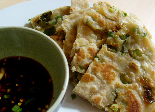 scallion pancakes with a smashed garlic scallion soy dipping sauce